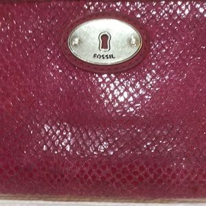 Fossil pink wallet that has been very much loved!